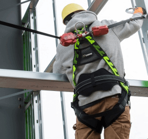 worker with power equipment harness